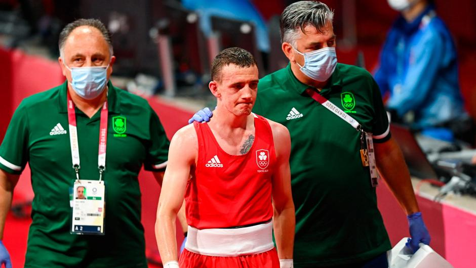 Brendan Irvine of Ireland, centre, with coaches Zaur Antia, left, and John Conlan, after defeat to Carlo Paalam