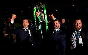 Ireland players Jamie Heaslip (left) Rob Kearney (centre) and Sean O' Brien celebrate. (Photo by Stu Forster/Getty Images)