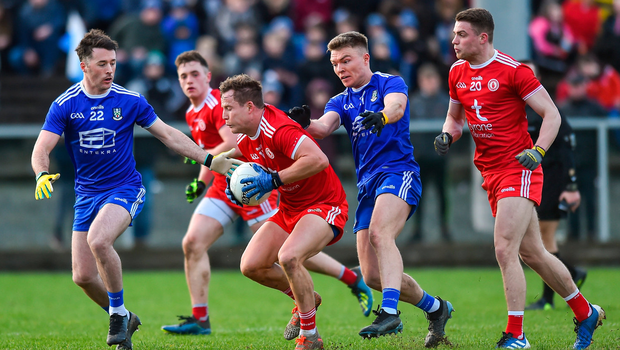 Kieran McGeary of Tyrone in action against CHristopher McGuinness and Conor McCarthy of Monaghan. Photo by Oliver McVeigh/Sportsfile