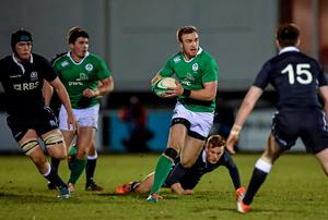 Ciaran Gaffney, Ireland, makes a break down the pitch on the way to setting up his side's first try