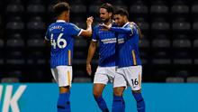 Brighton and Hove Albion's Alireza Jahanbakhsh (right) celebrates with team-mates Haydon Roberts (left) and Davy Propper