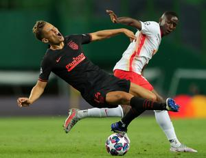 Atletico Madrid's Marcos Llorente in action with RB Leipzig's Amadou Haidara. Photo: Reuters