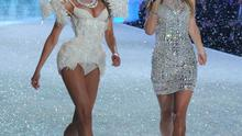 NEW YORK, NY - NOVEMBER 13:  Model Candice Swanepoel walks the runway wearing a corset with Singer Taylor Swift at the 2013 Victoria's Secret Fashion Show at Lexington Avenue Armory on November 13, 2013 in New York City.  (Photo by Bryan Bedder/Getty Images for Swarovski)