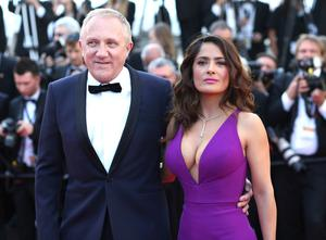 Francois-Henri Pinault, his wife Salma Hayek and his billionaire father Francois Pinault said they were immediately giving 100 million euros from their company, Artemis, to help finance repairs to fire damaged Notre Dame cathedral