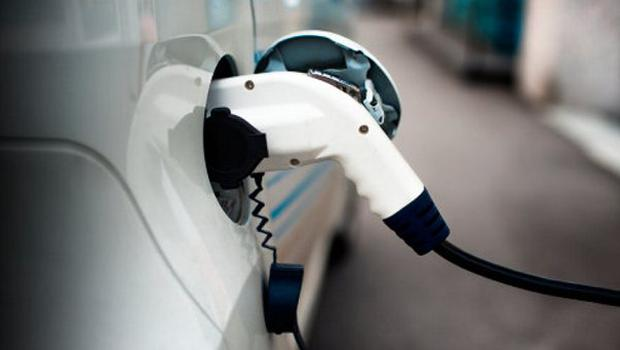 Charging an electric car with the power cable. Stock image