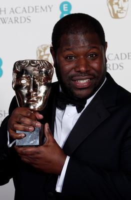 """Director Steve McQueen celebrates after winning best film for """"12 Years a Slave"""" at the British Academy of Film and Arts (BAFTA) awards ceremony at the Royal Opera House in London February 16, 2014."""