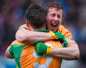 Corofin team mates Ronan Steede, left, and Gary Sice, celebrate after the final whistle