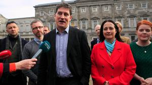 I've got a little list: Green Party leader Eamon Ryan and deputy leader Catherine Martin with party TDs on the plinth at Leinster House. Photo: Gareth Chaney/Collins
