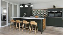 A kitchen sink works well in an island, and can be placed off centre as in this design by Savvy Kitchens