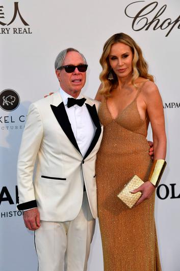 US fashion designer Tommy Hilfiger (L) and his wife Dee arrive on May 23, 2019 at the amfAR 26th Annual Cinema Against AIDS gala at the Hotel du Cap-Eden-Roc in Cap d'Antibes, southern France, on the sidelines of the 72nd Cannes Film Festival. (Photo by Alberto PIZZOLI / AFP)ALBERTO PIZZOLI/AFP/Getty Images
