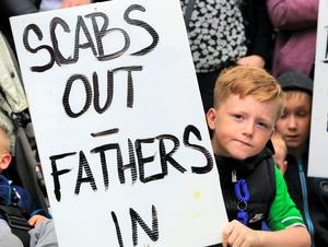 Cian Simpson, age 9, Tallght sopporting Greyhound bins workers as they march on City Hall to protest in support of the workers on strike at Greyhound Bins. Picture:Arthur Carron