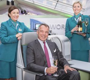 Aer Lingus CEO Christoph Mueller with cabin crew members Claire Sutton and Melanie Kialka. The new business class experience will be available on transatlantic flights from March 2015.