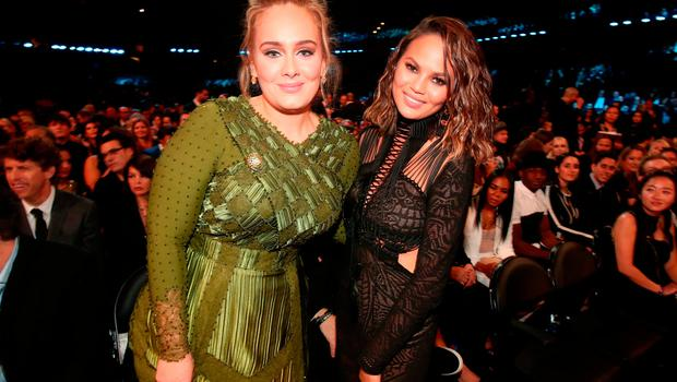 Singer Adele and media personality Chrissy Teigen during The 59th GRAMMY Awards at STAPLES Center on February 12, 2017 in Los Angeles, California.  (Photo by Christopher Polk/Getty Images for NARAS)