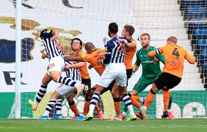 West Bromwich Albion's Ahmed Hegazi (left) scores his side's second goal of the game during the Sky Bet Championship match against Hull at The Hawthorns. Photo credit: Mike Egerton/PA Wire