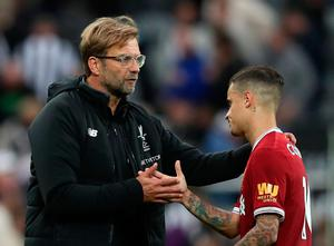 Liverpool manager Jurgen Klopp with Liverpool's Philippe Coutinho after the match