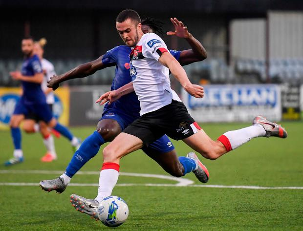 Dundalk's Michael Duffy is challenged by Waterford's Timi Sobowale. Photo: Sportsfile