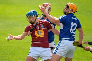 24 May 2015; Robbie Greville, Westmeath, in action against Matthew Whelan, centre, and Charles Dwyer, Laois. Leinster GAA Hurling Senior Championship Qualifier Group, Round 3, Laois v Westmeath. O'Moore Park, Portlaoise, Co. Laois. Picture credit: Brendan Moran / SPORTSFILE