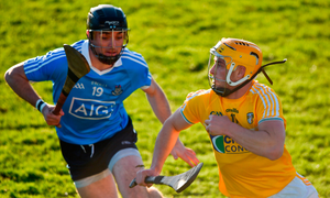 Conor Johnston of Antrim in action against Ronan Smith of Dublin. Photo by David Fitzgerald/Sportsfile