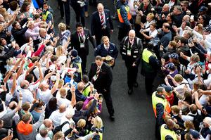 Former England rugby international Jonny Wilkinson (C) carries the Webb Ellis Cup between crowds prior to the opening ceremony of the 2015 Rugby World Cup outside Twickenham stadium in south west London on September 18, 2015. AFP PHOTO / FRANCK FIFE  RESTRICTED TO EDITORIAL USE, NO USE IN LIVE MATCH TRACKING SERVICES, TO BE USED AS NON-SEQUENTIAL STILLSFRANCK FIFE/AFP/Getty Images