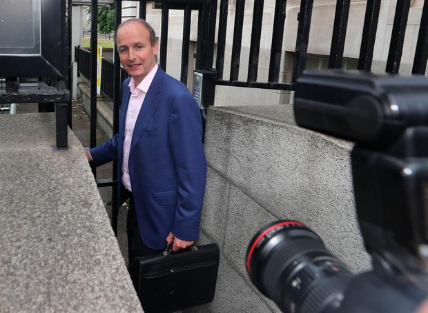 Fianna Fail leader Micheal Martin arrives at Government Buildings in Dublin. photo: Niall Carson/PA Wire