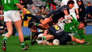 PILE-UP: Ireland's Darren Fay (r) gets tangled up with Australia's Scott Camporeale and Anthony Stevens. Photo: Damien Eagers/Sportsfile