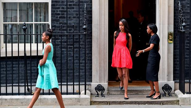 Malia (C) and Sasha Obama (C) leave Downing Street following a meeting with  Prime Minister David Cameron and his wife Samantha Cameron on June 16, 2015 in London, England.  (Photo by Jeff J Mitchell/Getty Images)
