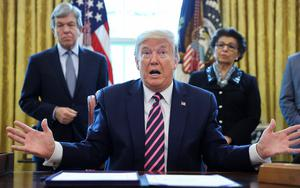 U.S. President Donald Trump speaks to reporters in the Oval Office at the White House in Washington, U.S., April 24, 2020. REUTERS/Jonathan Ernst