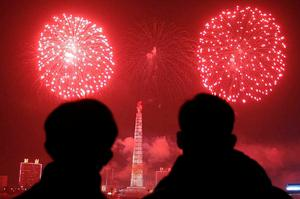 Fireworks explode over Juche Tower and the Taedong River in Pyongyang, North Korea to celebrate the New Year. Photo: AP Photo/Kim Kwang Hyon
