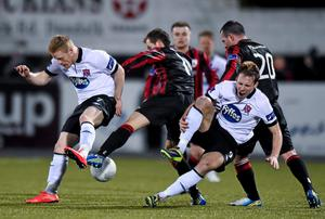 Pat Flynn, Longford Town, in action against Daryl Horgan, left, and David McMillan, Dundalk