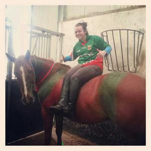 Laurena Kelly on her horse Jack who's wearing his county colours