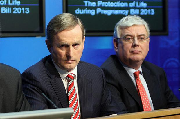Taoiseach Enda Kenny and Tanaiste Eamon Gilmore at the media briefing at Government Buildings following the publication of The Protection of Life during Pregnancy Bill 2013