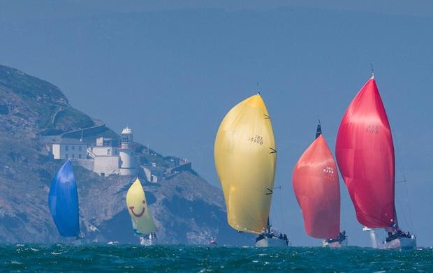 Part of the 56-strong fleet in the Round Ireland pass Wicklow Head lighthouse. Photo: David Branigan/Oceansport