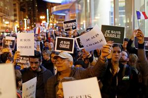 People gather for a vigil outside the Consulate General of France to remember the victims of an attack on satirical magazine Charlie Hebdo in Paris, in San Francisco, California January 7, 2015.   REUTERS/Stephen Lam