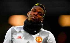 Paul Pogba of Manchester United looks on as he warms up prior to the Premier League match between Manchester United and Liverpool at Old Trafford yesterday. Laurence Griffiths/Getty Images