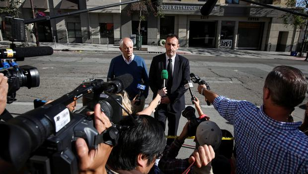 Philip Grant, Consul General of Ireland to the Western United States (R) speaks to the media with Berkeley Mayor Tom Bates (L) following a wreath-laying ceremony at the scene of a 4th-story apartment building balcony collapse in Berkeley, California June 16, 2015. REUTERS/Elijah Nouvelage