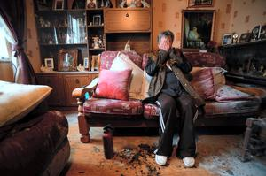 Grandmother Nelly Halligan in the petrol-bomb damaged living room of her home in Ardmore Park, Waterford. Picture: Caroline Quinn