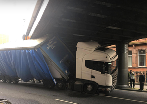 The articulated lorry is wedged firmly under the bridge in Amiens Street