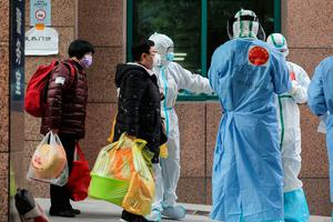 Patients infected by the COVID-19 coronavirus leave from Wuhan No.3 Hospital to Huoshenshan Hospital in Wuhan in China's central Hubei province on March 4, 2020. - China on March 4 reported 38 more deaths from the new coronavirus but a fall in fresh cases for a third consecutive day. (Photo by STR / AFP) / China OUT (Photo by STR/AFP via Getty Images)
