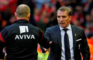 Liverpool manager Brendan Rodgers shakes hands with Norwich manager Alex Neil after the game
