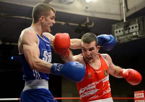 Adam Nolan, left, Bray Boxing Club, evades a punch by John Joe Joyce, St. Michael's Boxing Club, Athy, during their 69kg bout.