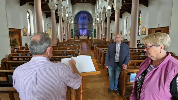 A man signs the Book of Condolences which was opened for the victims of the California balcony collapse at Our Lady of Perpetual Succour Church, Foxrock this afternoon...Picture Colin Keegan, Collins Dublin.