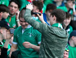 A Gonzaga College supporter has his hair shaved during the Senior Cup Semi Final between Blackrock College and Gonzaga College at Donnybrook. Photo: Damien Eagers