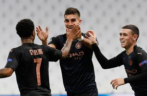 ON TARGET: Manchester City's Ferran Torres celebrates scoring their first goal with Raheem Sterlingand Phil Foden (right)