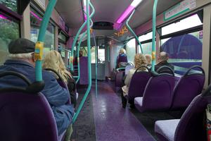 People using a bus. Stock photo: Getty
