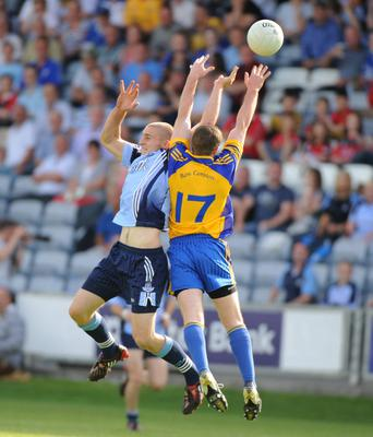 Ronan Brady of Roscommon. challenges Dublin's Eoghan O'Gara for the ball. Picture credit: Matt Browne / SPORTSFILE