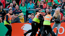 Mick Barrett is restrained as he tries to confront referee Cormac Reilly during the closing stages of the All-Ireland semi-final