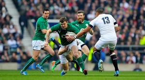 Ireland centre Brian O' Driscoll makes a break during the RBS Six Nations match between England and Ireland at Twickenham