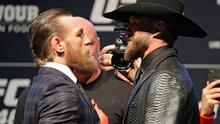 "Conor McGregor, left, and Donald ""Cowboy"" Cerrone face-off"