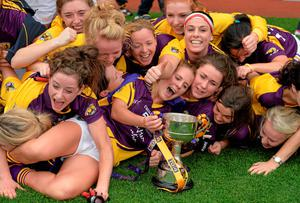 The Wexford players celebrate their victory over New York in yesterday's junior decider at Croke Park. Brendan Moran / SPORTSFILE