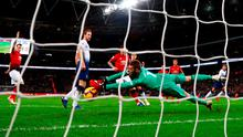In safe hands:  David De Gea makes a crucial save from Tottenham's Dele Alli (far right) during the second half at Wembley yesterday. Photo: Clive Rose/Getty Images